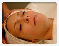 woman receiving gemclay firming mineral eye serum